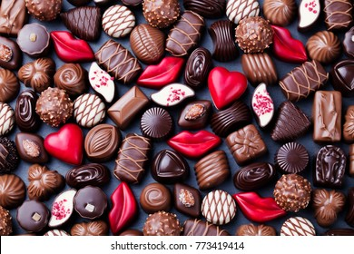 Assortment of fine chocolate candies, white, dark and milk chocolate Sweets background. Copy space. Top view.
