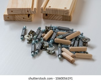 An assortment of flat pack furniture fixings