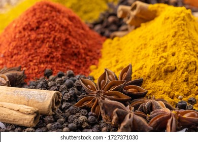 Assortment of fragrant Indian spices in the market. Colorful and fragrant spices pour heap