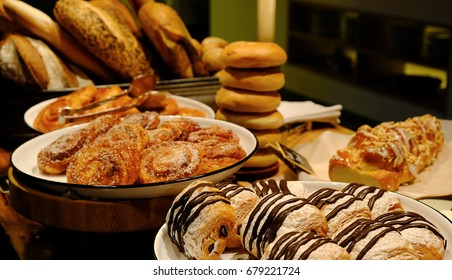 Assortment of French Pastries in the Trays and Plates, Breads, Group of Bakeries, Sweet Corner in Buffet Line