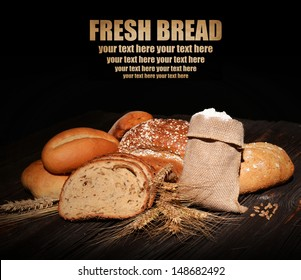 Assortment of fresh bread on black background
