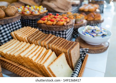 Assortment of fresh bread on table in buffet