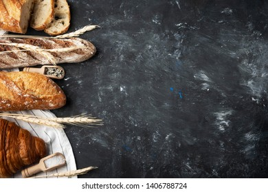 Assortment of fresh bread. Still life captured from above, banner layout.Healthy homemade bread. Copy space.