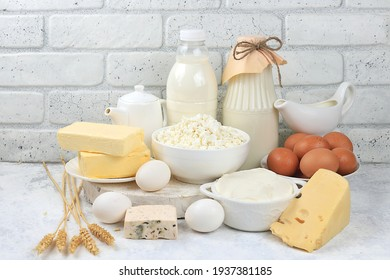 Assortment of fresh dairy products, healthy breakfast with ingredients, natural nutrition concept, maintaining healthy intestinal microflora, diet food, rustic table,