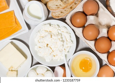 assortment of fresh dairy products on white background, top view horizontal