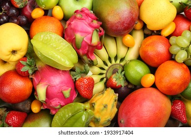 Assortment of fresh exotic fruits as background, top view