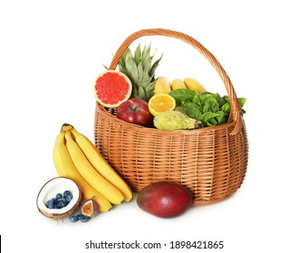 Assortment of fresh exotic fruits in basket on white background