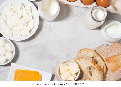 assortment of fresh farm dairy products on white background, top view horizontal