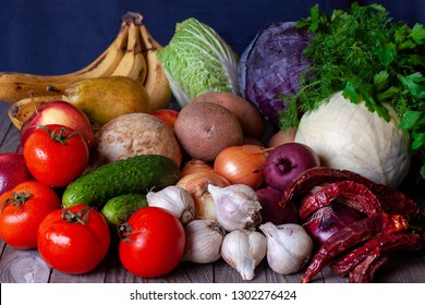 Assortment of fresh fruits and vegetables. Composition with assorted raw organic vegetables