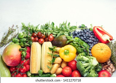 Assortment of fresh fruits and vegetables.  Detox, vegan and clean diet eating. Image with copy space