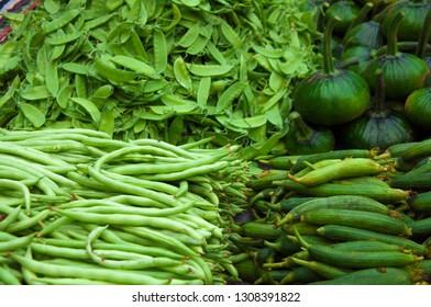 Assortment of fresh green veggies: beans, pumpking