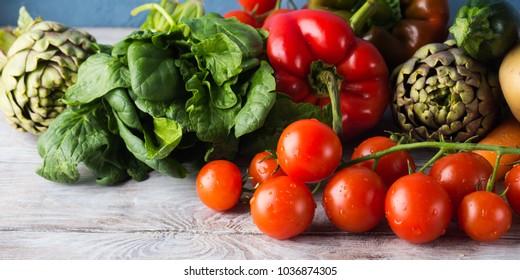 Assortment of fresh italian vegetables on wooden table
