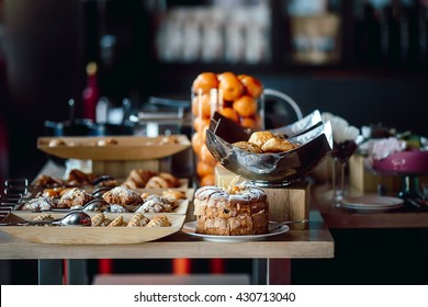 Assortment of fresh pastry and mandarin on table in buffet