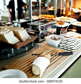 Assortment of fresh pastry on table in buffet with toaster