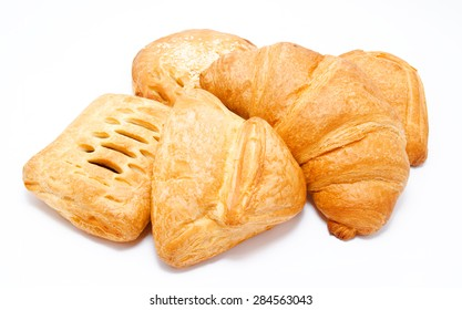 Assortment of fresh puff pastry isolated on a white background