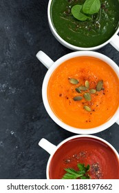 assortment of fresh vegetable soup on a dark background, top view, vertical