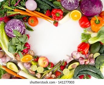 Assortment of Fresh Vegetables and Fruits Making Heart Shape Frame with White Middle