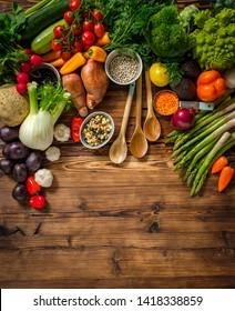 Assortment of fresh vegetables on wooden background