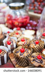 Assortment of freshly baked goods topped with cherries