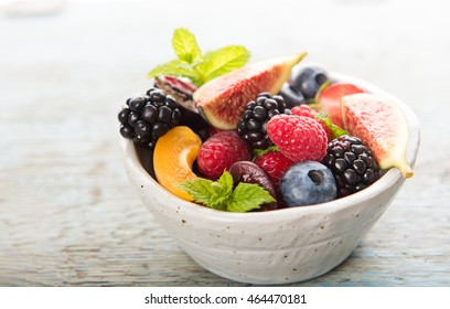 Assortment of Freshly Picked Berries in White Bowl