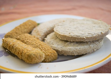 assortment of frozen food with fish sticks and soy cutlets
