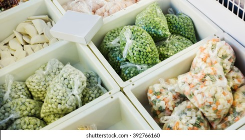 Assortment of frozen vegetables and dumplings in supermarket fridge