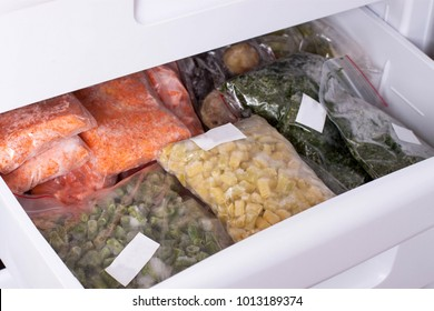 Assortment of frozenVegetables in home fridge. Frozen food in the freezer