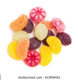 An assortment of fruit flavored hard candy on a white background