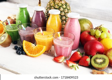 Assortment of fruit smoothies in glass bottles. Fresh organic Smoothie ingredients. Smoothies for health or detox diet food concept.