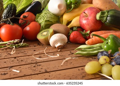 Assortment of fruits and vegetables on a wooden table close up. Horizontal composition. Front view