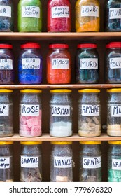 Assortment of glass jars on shelves in herbalist shop on a traditional Moroccan market (souk) in Marrakech, Morocco