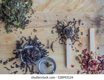assortment of green, black and red mixed teas all filling the air with fragrant and aromatic delicious smells that bring joy and peace to the heart and soul as well as mindfulness loose tea