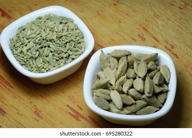 An assortment of green cardamoms and fennel seeds used in cooking