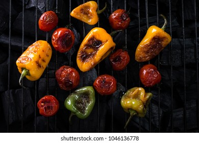 Assortment of grilled mini vegetables on dark background