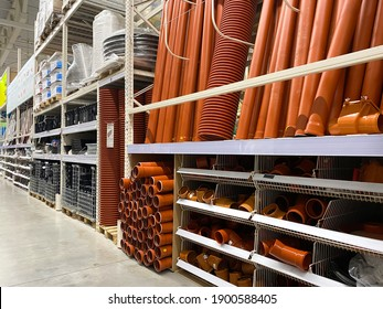 Assortment of a hardware store, pipes. Building materials and manufactured goods are stacked and put up for sale in a hardware store
