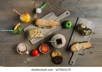 Assortment of healthy food: paninis, sandwiches, cookies, fruit, coffee and focaccias