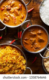 assortment of indian curries and rice dishes in flat lay composition