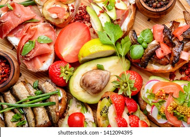 Assortment of italian traditional bruschetta.Appetizing bruschetta.Variety of small sandwiches
