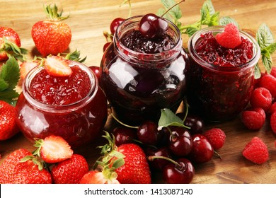 assortment of jams, seasonal berries, cherries, mint and fruits with strawberry