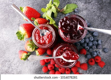assortment of jams, seasonal berries, mint and fruits