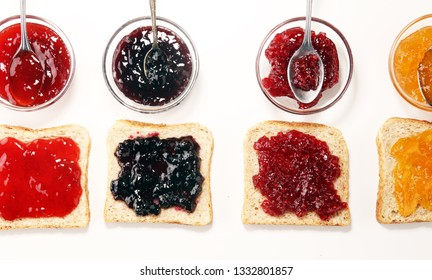 assortment of jams, seasonal berries, plums, mint and fruits with strawberry and currants