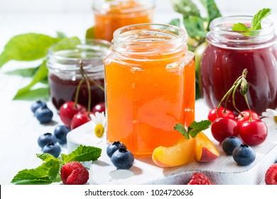assortment of jams and seasonal fruits, closeup