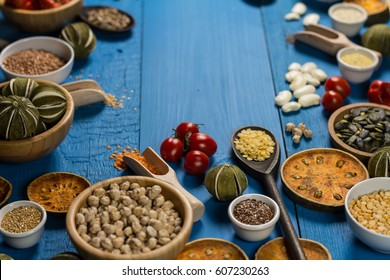 Assortment of legumes, grain and seeds. Various types of grains, rice, legumes spices and herbs. Place for typography
