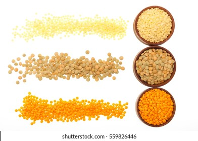 Assortment of lentils in a wooden bowl, green, red, couscous grains on a white background. Top view, close-up.