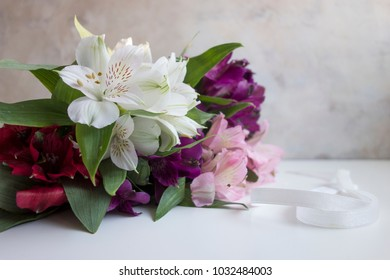 An assortment of lilies in white, red, pink and purple.  The botanical name is Alstroemeria, but commonly known as Lily of the Incas or Peruvian Lilies.
