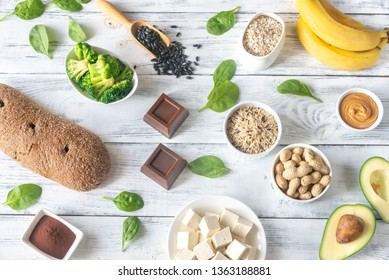 Assortment of magnesium-rich foods on the wooden background