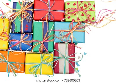 Assortment of many colorful presents on a white background