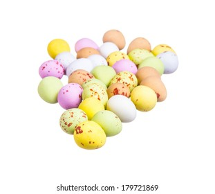 Assortment of mini eggs on white background