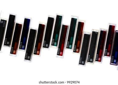 An assortment of mini-dv cassette tapes, over white.
