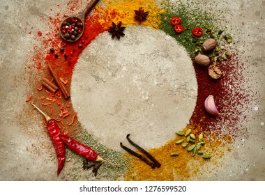 Assortment of natural spices on a light beige ( sand ) slate, stone or concrete background.Top view with copy space.